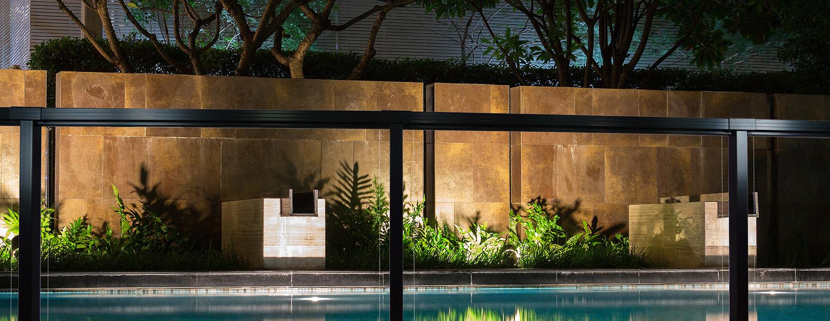 Framed glass deck railing around pool