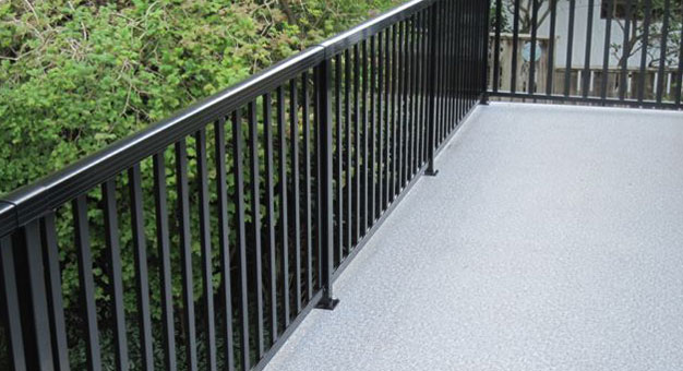 wide picket railing on a patio