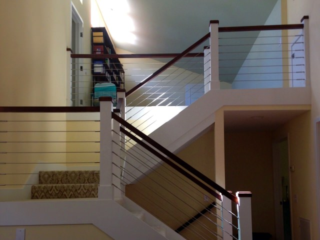 Interior cable railing system on stairs
