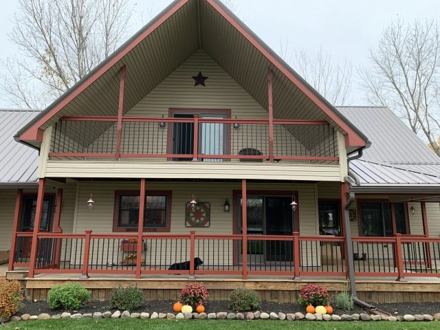 Red traditional deck railing systems