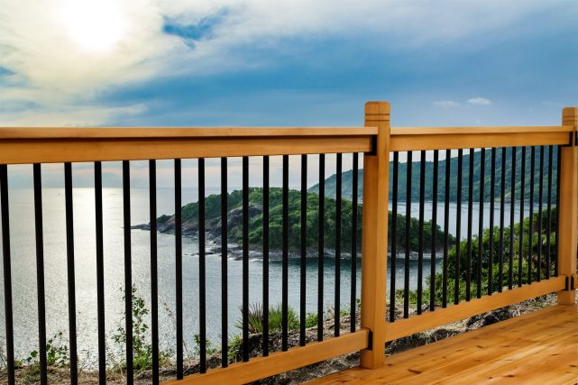 Cedar and aluminum traditional style deck railing